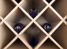 Botellas azules en el armario Fotos de archivo libres de regalías