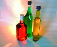 Botellas coloreadas Fotos de archivo libres de regalías