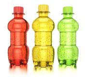 Botellas coloreadas con las bebidas Imagen de archivo libre de regalías