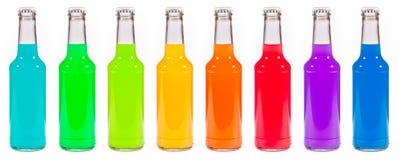 Botellas coloreadas multi Imagen de archivo libre de regalías