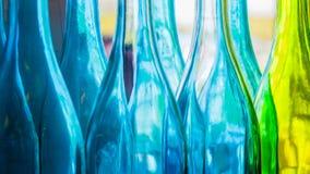 Botellas coloridas azules y verdes Fotos de archivo