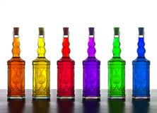 Botellas coloridas del alcohol Fotografía de archivo
