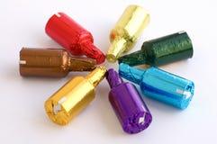 Botellas coloridas del chocolate Foto de archivo