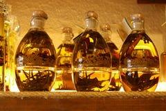 Botellas con aceite de oliva Imágenes de archivo libres de regalías