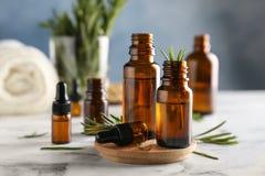 Botellas con aceite esencial del romero Fotografía de archivo libre de regalías