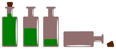 Botellas con alcohol en el fondo blanco Imagen de archivo