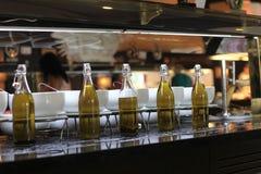 Botellas con diversos tipos de aceite de oliva Foto de archivo libre de regalías