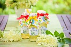 Botellas con el jarabe del elderflower Imagen de archivo libre de regalías