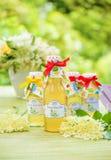 Botellas con el jarabe del elderflower Fotografía de archivo libre de regalías