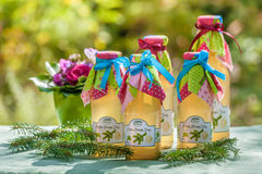 Botellas con el jarabe del pino y del limón Imagen de archivo libre de regalías
