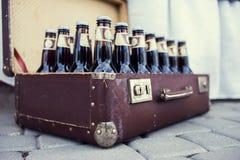 Botellas con la cerveza Imagenes de archivo
