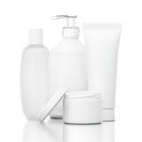 Botellas cosméticas blancas Fotos de archivo libres de regalías
