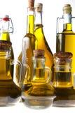 Botellas de aceite de oliva virginal adicional Foto de archivo