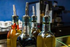 Botellas de aceite en la tabla de comida fría foto de archivo libre de regalías