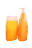 Botellas de aceite o de protección solar de Sunbath imagen de archivo libre de regalías