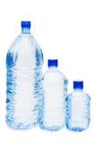 Botellas de agua aisladas sobre blanco Fotos de archivo libres de regalías