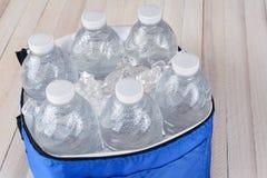 Botellas de agua en refrigerador Imagen de archivo libre de regalías
