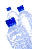 Botellas de agua plásticas Fotos de archivo libres de regalías