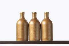 Botellas de cerámica en el estante Imagen de archivo libre de regalías