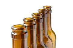 Botellas de cerveza vacías de cerveza dorada Foto de archivo libre de regalías