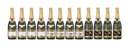 Botellas de Champán con varias escrituras de la etiqueta Foto de archivo libre de regalías