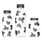 Botellas de cristal aisladas de leche Fotos de archivo libres de regalías