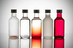 Botellas de cristal coloridas Imagenes de archivo