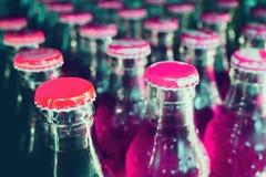 Botellas de cristal con los refrescos Fotos de archivo