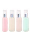 Botellas de cristal cosméticas en blanco con la bomba Imagen de archivo libre de regalías