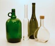 Botellas de cristal de diversas formas Imágenes de archivo libres de regalías