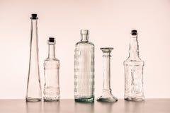Botellas de cristal de diversas formas fotos de archivo libres de regalías