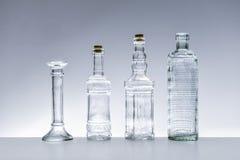 Botellas de cristal de diversas formas foto de archivo libre de regalías