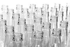 Botellas de cristal vacías. Aún-vida en un fondo blanco Imagenes de archivo
