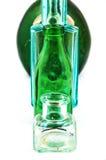 Botellas de cristal viejas aisladas en el fondo blanco Foto de archivo