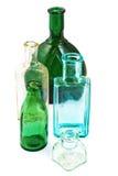Botellas de cristal viejas aisladas en el fondo blanco Fotos de archivo libres de regalías