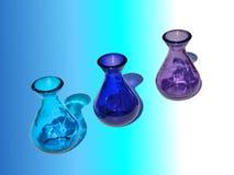 3 botellas de cristal y reflexiones Foto de archivo
