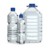 Botellas de diversos tamaños del agua Imágenes de archivo libres de regalías