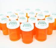 Botellas de píldora anaranjadas Fotografía de archivo