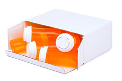 Botellas de píldora vacías en una caja Imagen de archivo