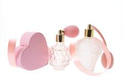 Botellas de perfume y rectángulo de regalo Imagen de archivo