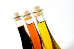 Botellas de petróleos coloreados aislados en blanco Imagenes de archivo