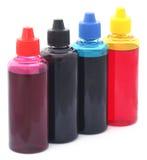 Botellas de tinta de impresora Imagen de archivo