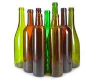 Botellas de vino coloridas brillantes. Aún-vida en un fondo blanco Foto de archivo libre de regalías