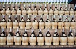 Botellas de vino de mimbre Fotos de archivo libres de regalías