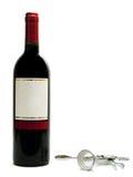 Botellas de vino rojo con el sacacorchos foto de archivo libre de regalías