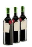 Botellas de vino rojo con la escritura de la etiqueta en blanco fotos de archivo