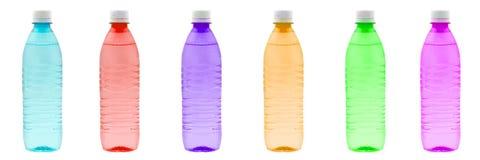 Botellas del color en fila Fotografía de archivo libre de regalías