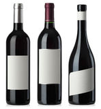 Botellas del espacio en blanco del vino rojo con las escrituras de la etiqueta Imagen de archivo libre de regalías