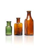 Botellas del viejo estilo en fila Fotografía de archivo
