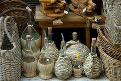 Botellas del vino y de petróleo con el mimbre Foto de archivo
